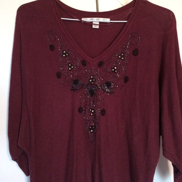 Size S burgundy LC sweater with beading LC Lauren Conrad Size S light 3/4 length burgundy sweater. Dolman sleeves, sweater is slimmer towards waist. Very flattering. Beading detail is black/iridescent/clear. Beautiful sweater. LC Lauren Conrad Tops Blouses