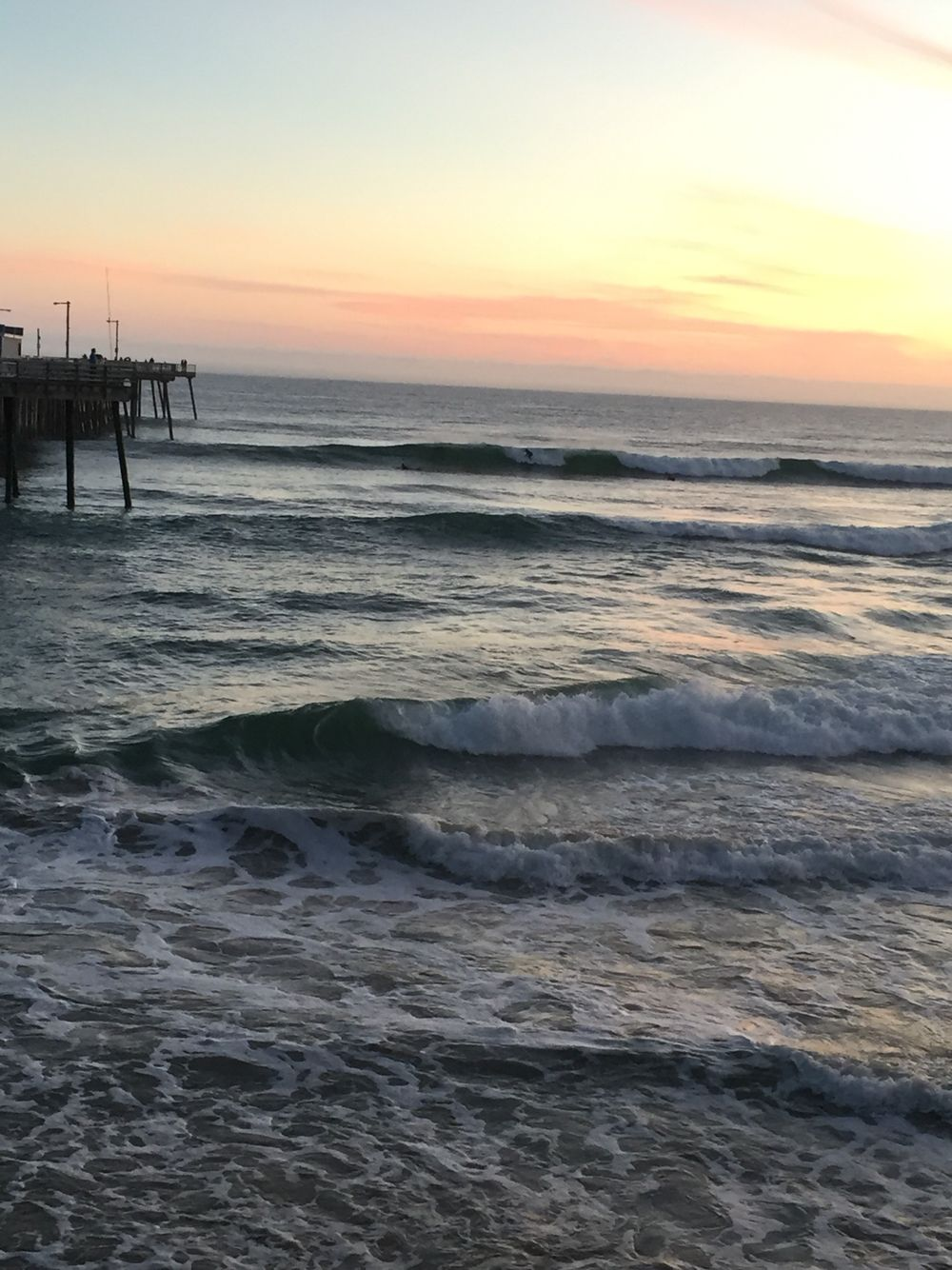 Pismo Pier sunset surfers