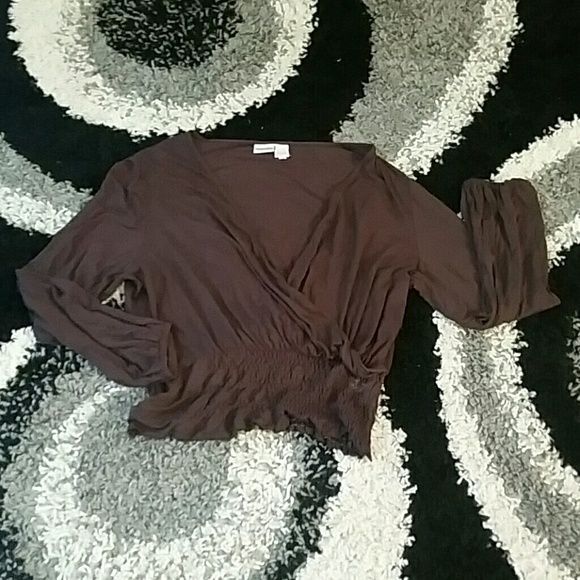 crisscross neckline shirt Supercute Chocolate blouse with a plunging neckline and banded waist to accentuate figure or create waistline , criss cross neckline can be worn with or without a tank underneath, in excellent used condition..true to size Tops