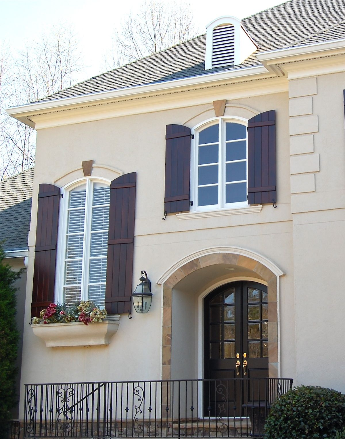 Stucco with brick wainscoting bluegray shutters Home makeover