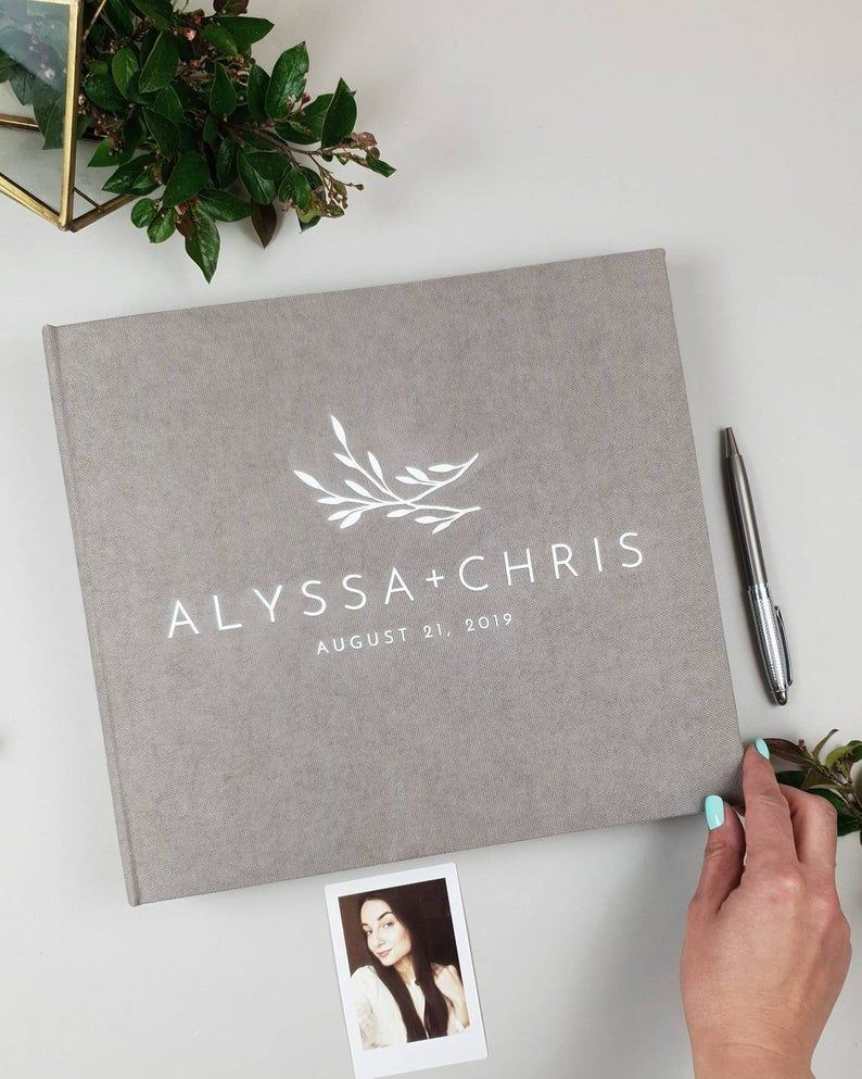 Gray instax photo guestbook with white lettering as