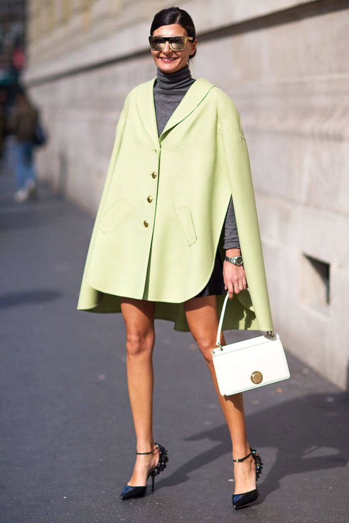 Giovanna Battaglia in pastel lime green cape #coat street styleduringFall Winter 2014 #PFW
