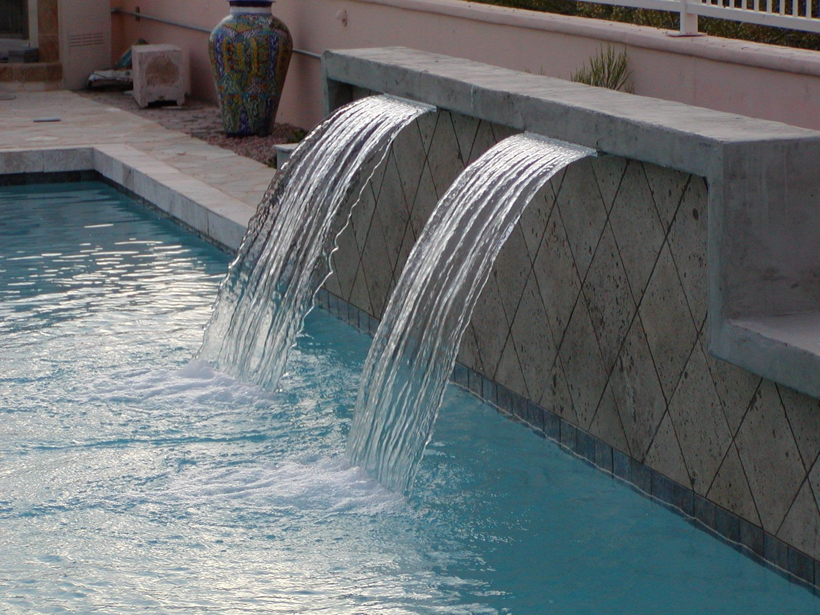Replace boring back wall of pool with something like this...multiple ...