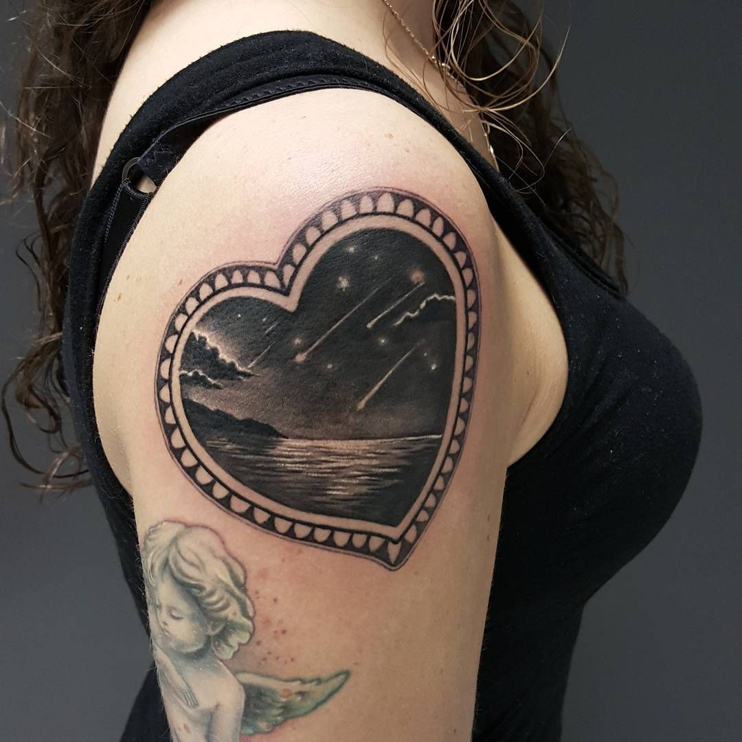 Heart shaped frame and seashore and falling stars inside for Tattoos in the heart