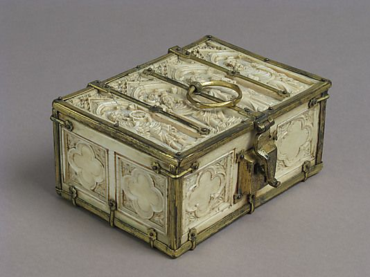Small casket,14th century. French.  Ivory,gilt copper mounts.