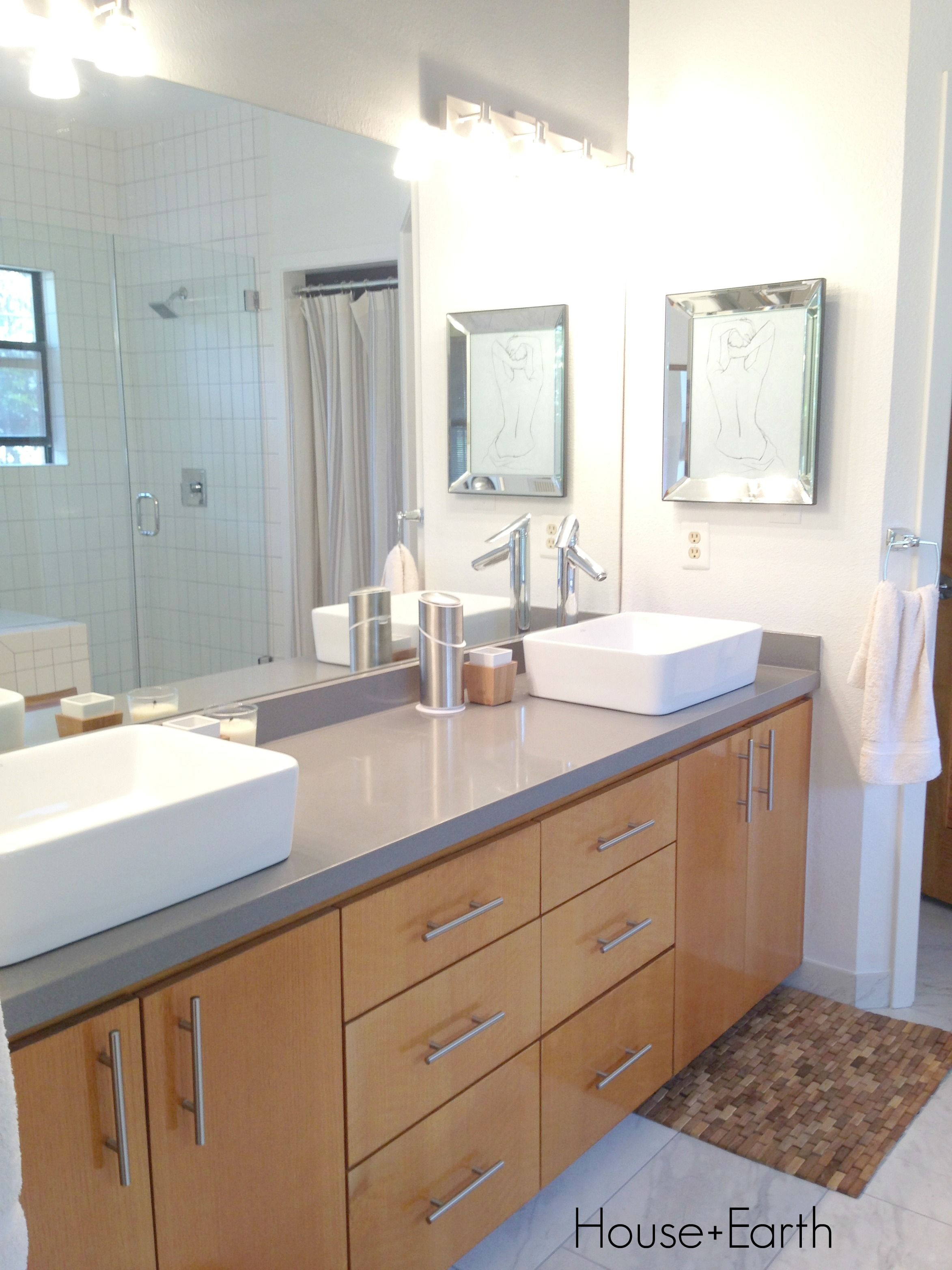 Bathroom Renovation Silestone Grey Expo Counter Top White Vessel Sinks Stained Cabinetry And Faux Marble Tiled Floor
