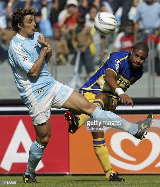 Adriano of Parma passes the ball past Oddo of Lazio during ...
