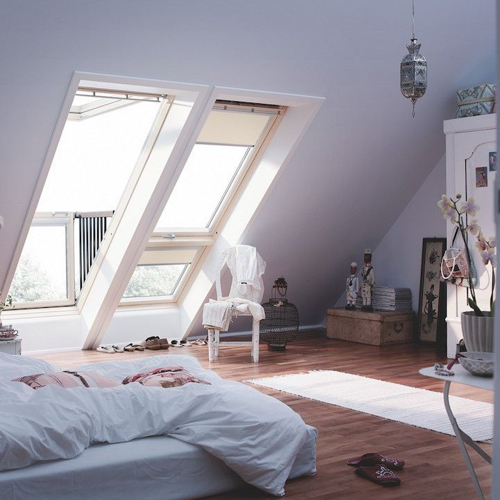 Attic room with a window-balcony system