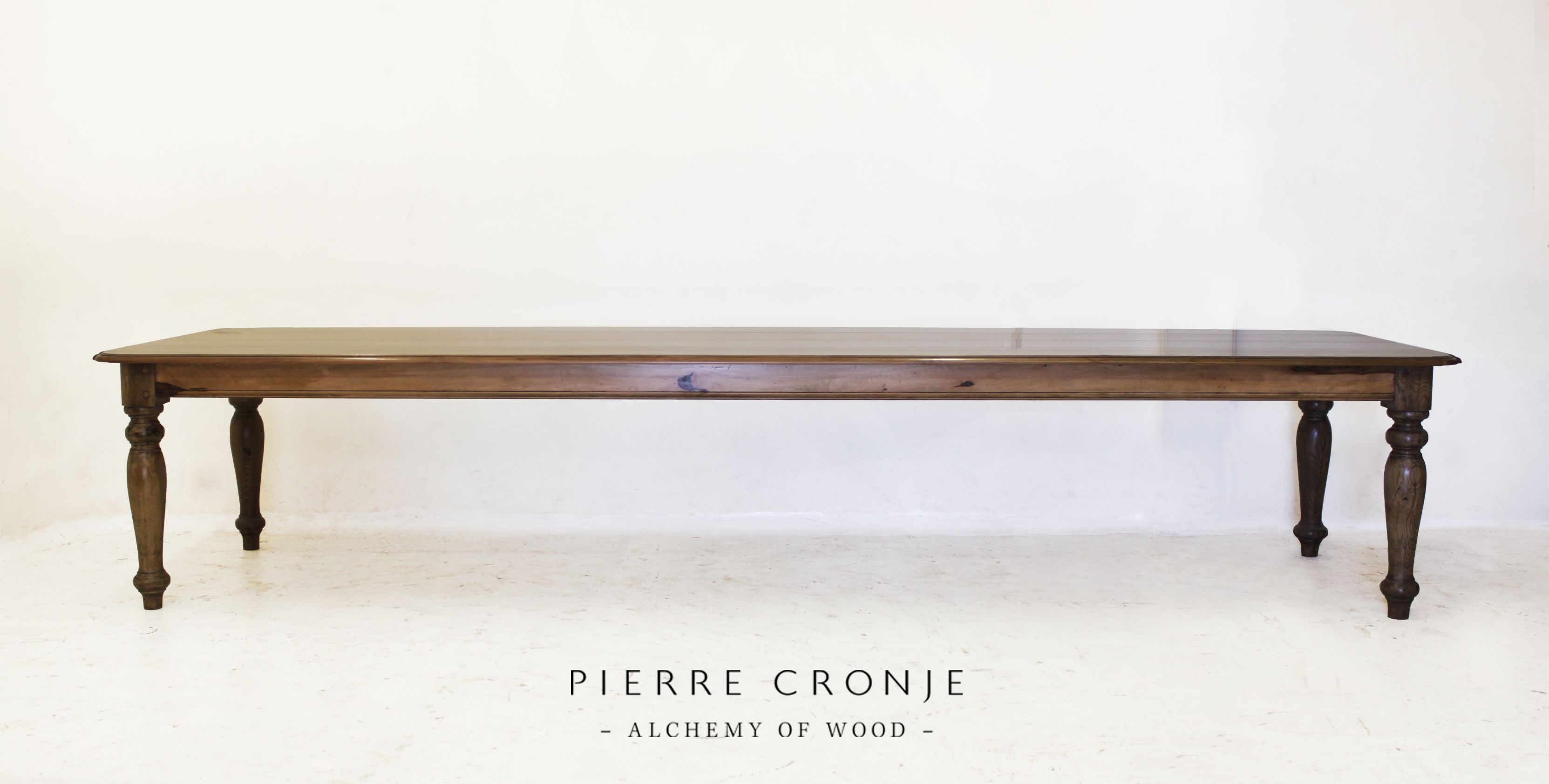 A beautiful 4m long Pierre Cronje King Dining Table