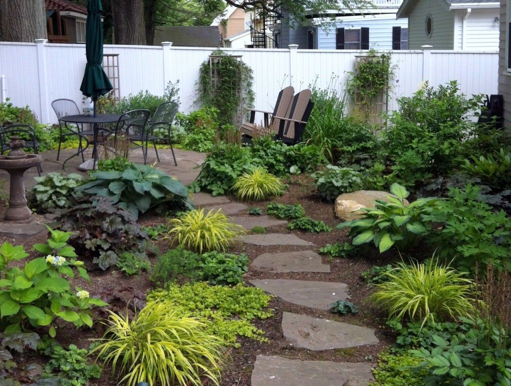 Pathways amp steppers sisson landscapes - Garden And Patio Simple Backyard Landscape Ranch House Design With Stepping Stone Between Backyard Garden With Herbs And Vegetable Plants Plus Small Round