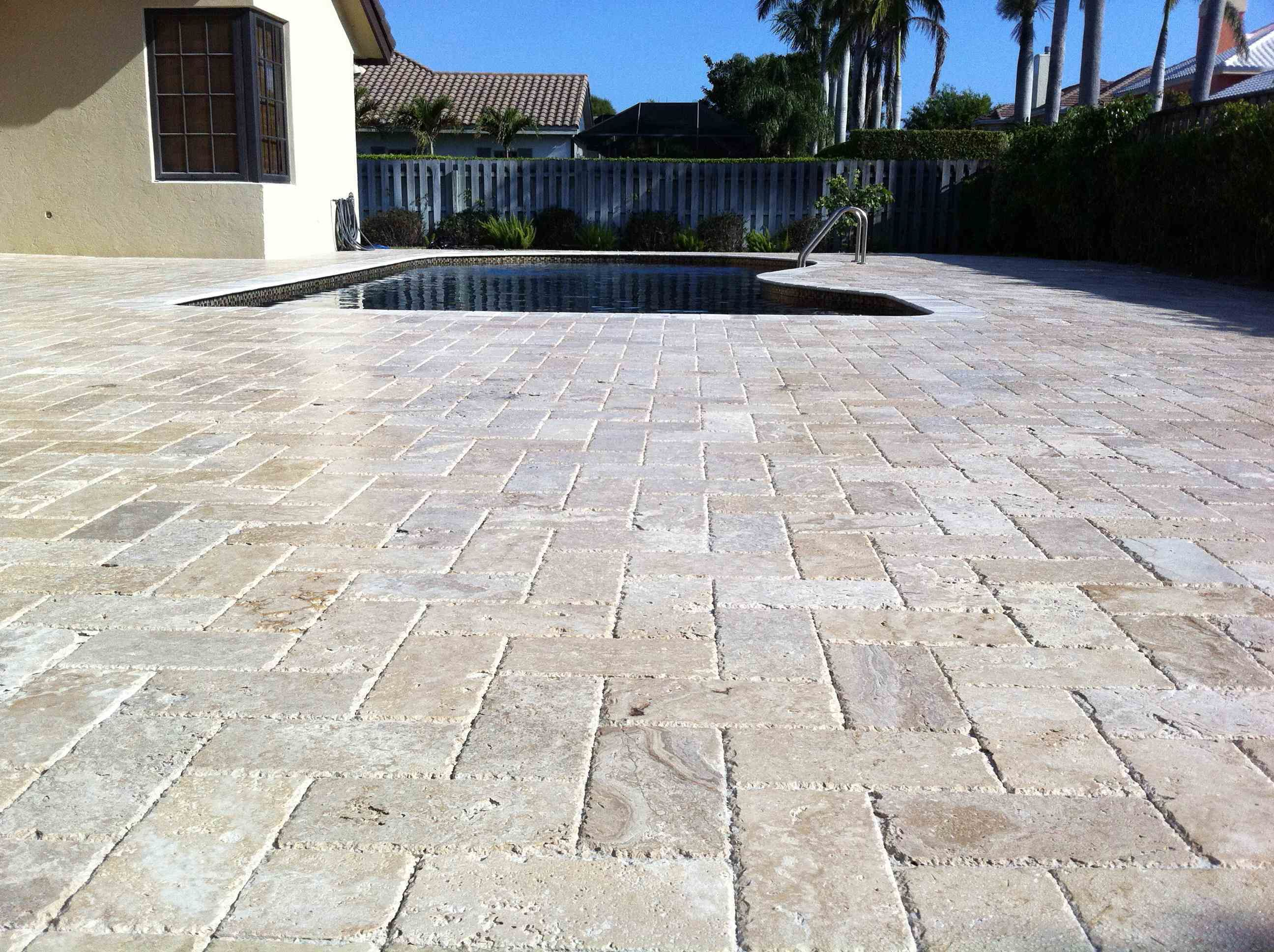 pool patio with pavers | pattern pavers | travertine pavers
