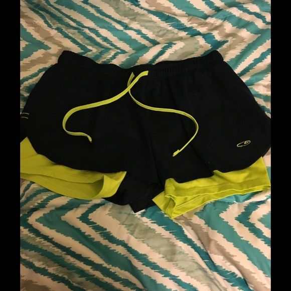 Layered Running Shorts Size Large Champion layered running shorts. Size large.  Excellent condition.  Important:  .  I make sure all items are freshly laundered as applicable (shoes and tagged items, I don't remove the tags and wash).  However, not all my items come from pet/smoke free homes.  Low pricing reflective of this. Thank you for looking! Champion Shorts