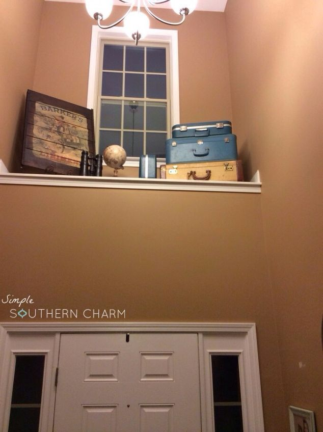 Add A Shelf Above The Door To Break Up The Large Wall Space In A