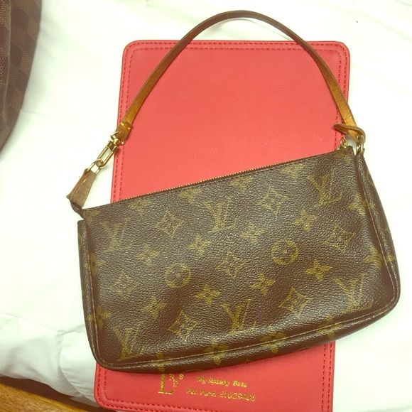 Authentic Louis Vuitton monogram pouchette Great condition. No stains inside,canvas is good. A little patina on leather strap but I change to a crossbody sometimes. Must have if you collect Louis Vuitton. Use for make up,Cash and credit cards if out. Cross posted and priced for fees. Louis Vuitton Bags Clutches & Wristlets