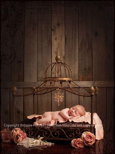 newborn princess portrait in a iron bed