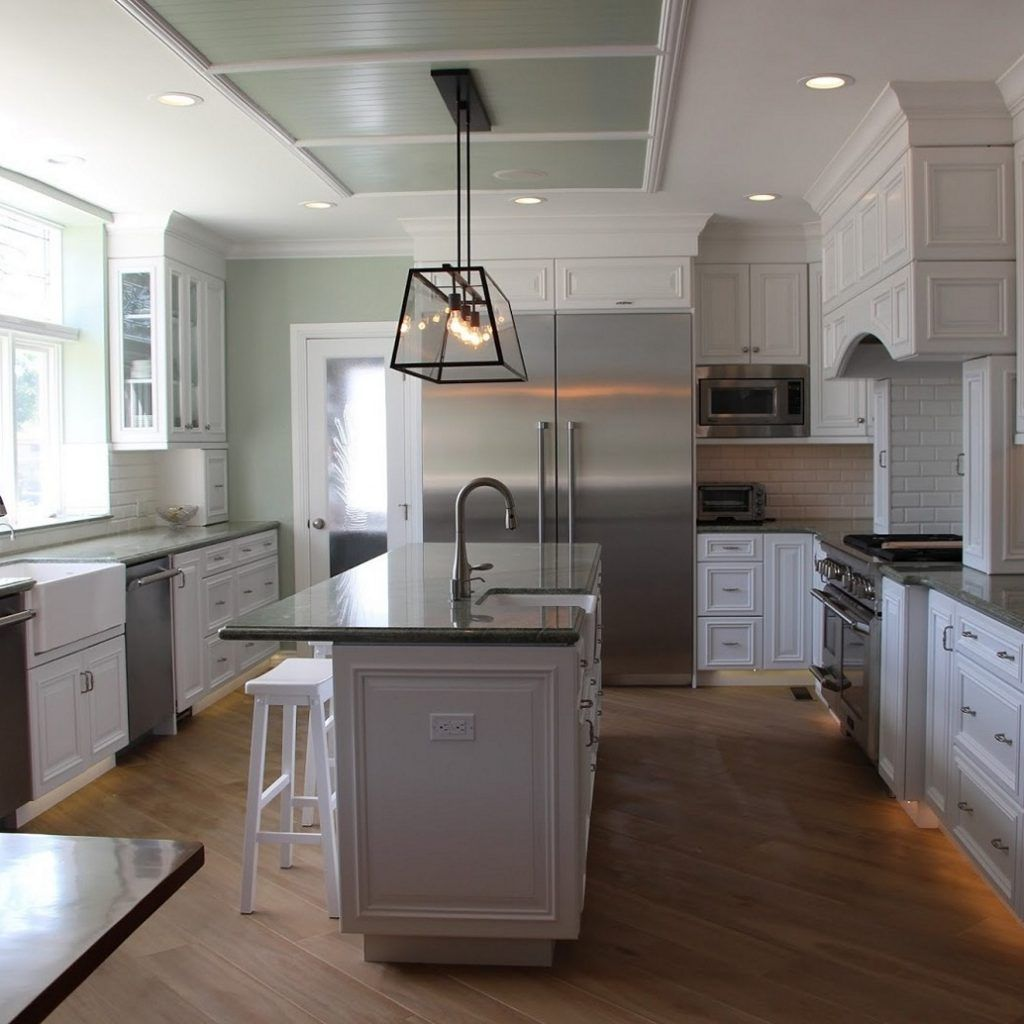 Bar height kitchen island  Light Gray Kitchen Cabinets With Dark Floors  Kitchen Cabinets