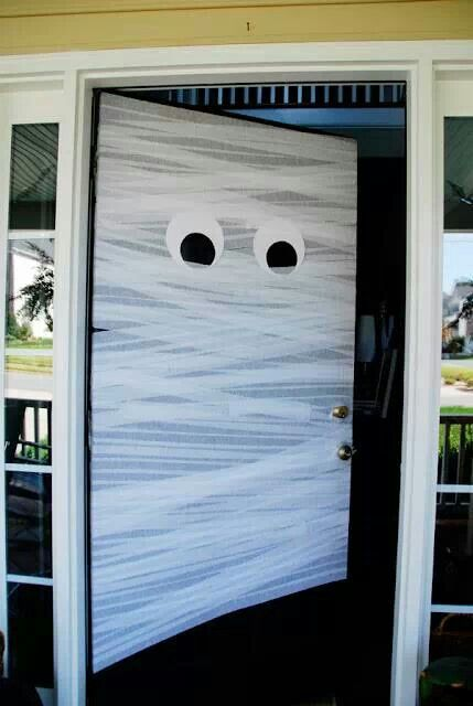 DIY Halloween Door  http://honeyandfitz.com/2011/10/27/diy-halloween-front-door-mummy/