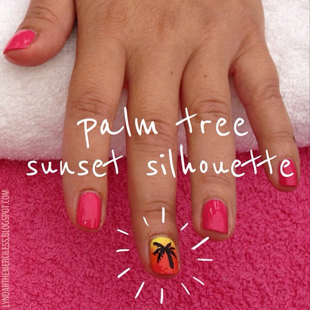 Palm tree nail art silhouetted against a gradient sunset background