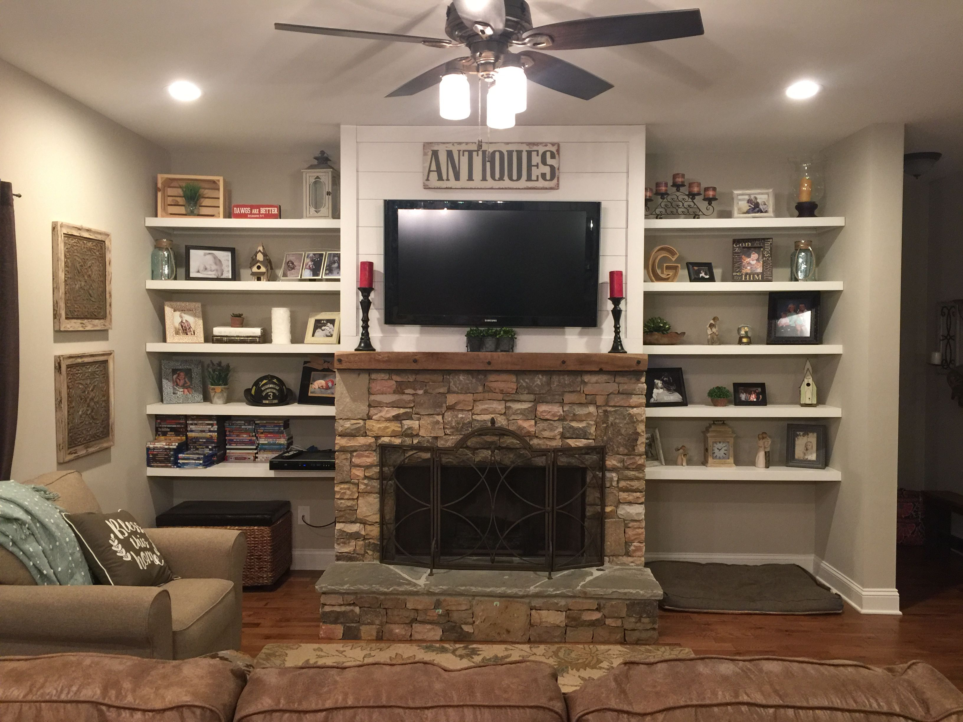 Stacked rock fireplace barnwood mantel shiplap top with floating