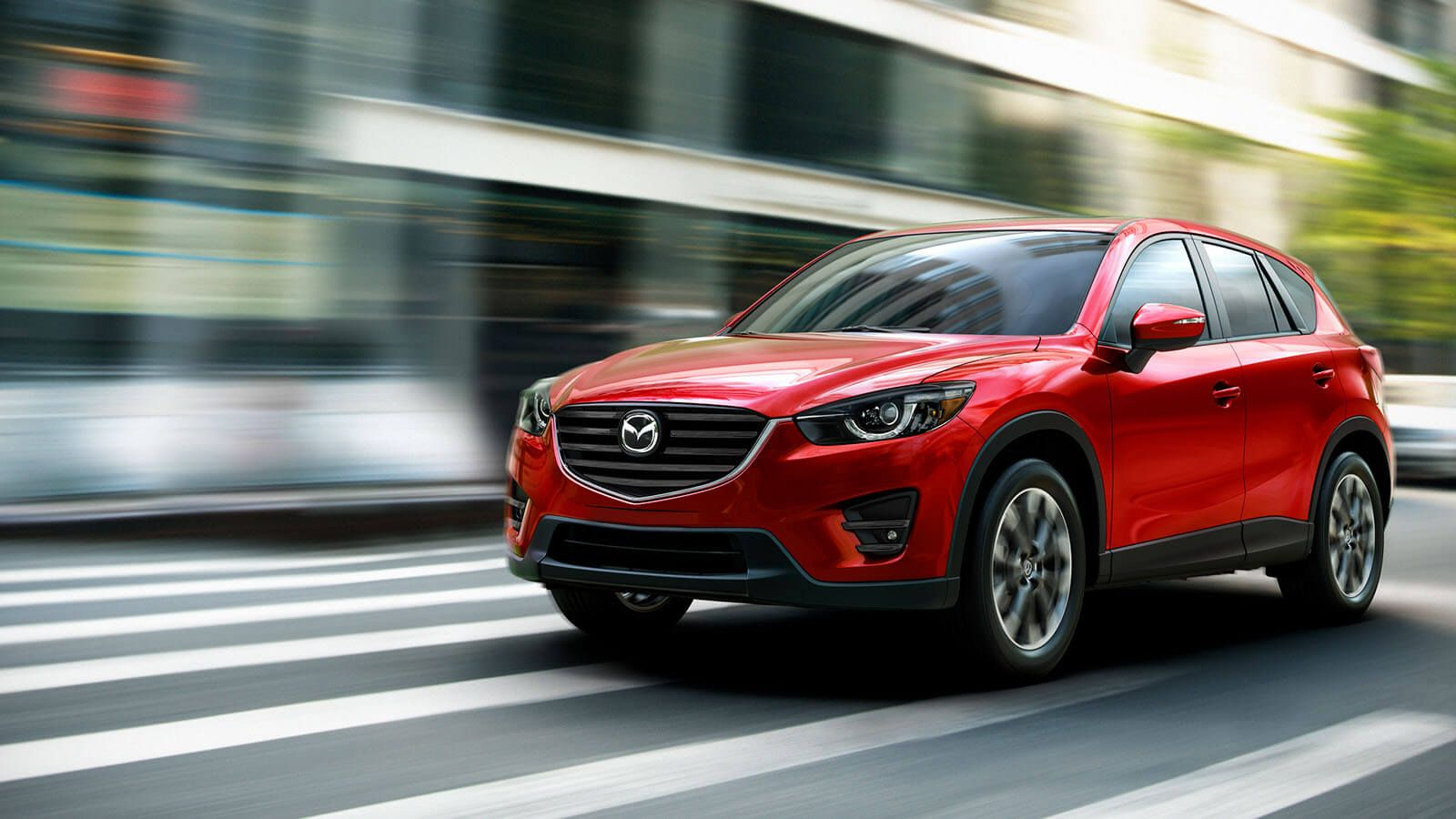 Side view of a 2016 Mazda CX5 in Soul Red Mica Mazda