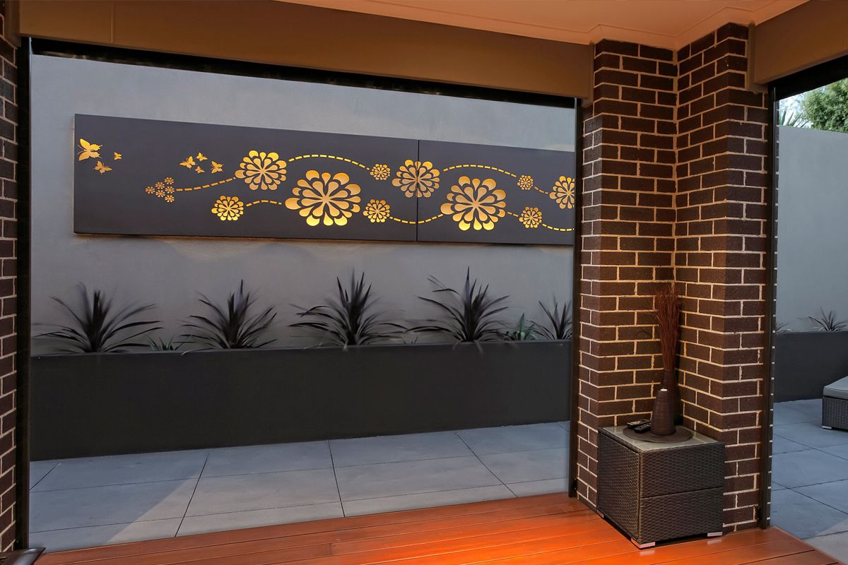 Outdoor living area with feature wall art flower wave custom