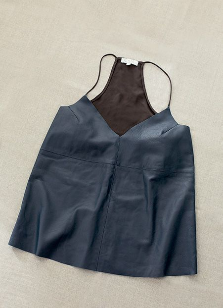For her Leather Camisole: As any woman will tell you, the right layering piece can make or break a look. This navy leather and charcoal-grey silk number by Cami NYC works with or without a jacket, dressed up or dressed down.