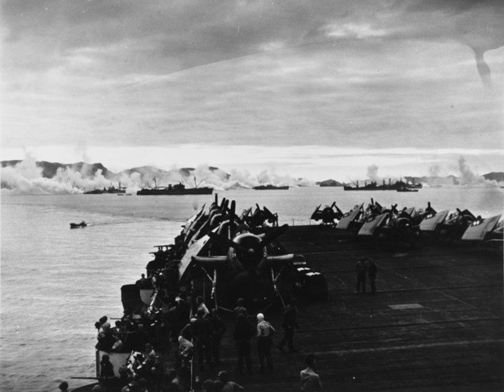 Ships in Kerama Retto anchorage spread an anti-kamikaze smoke screen, 3 May 1945, seen from USS Sargent Bay (CVE-83)