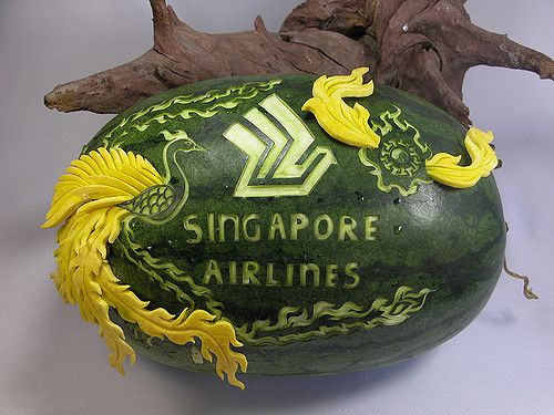 Logo carved into watermelon, with squash carving insertion