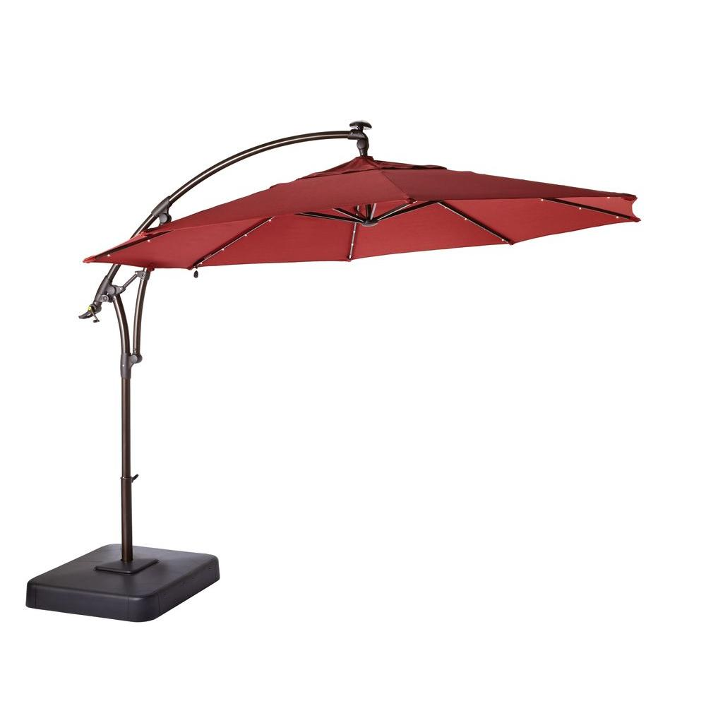 Hampton Bay 11 Ft Led Round Offset Outdoor Patio Umbrella In Chili Red Yjaf052 The Home Depot Offset Patio Umbrella Patio Umbrella Outdoor Patio Umbrellas