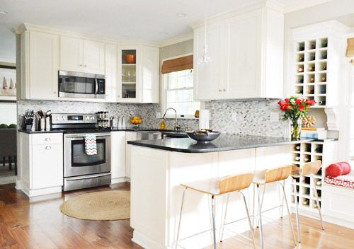 House Crashing: Classic & Natural With A Twist   Young House Love.  The basics of this are very similar to our plan--white cabinets and black countertop. I love the pop of red and wood accents.