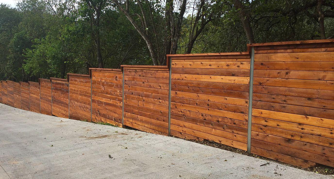 Horizontal Fence On A Slope Sloped Yard Modern Fence Fence Design