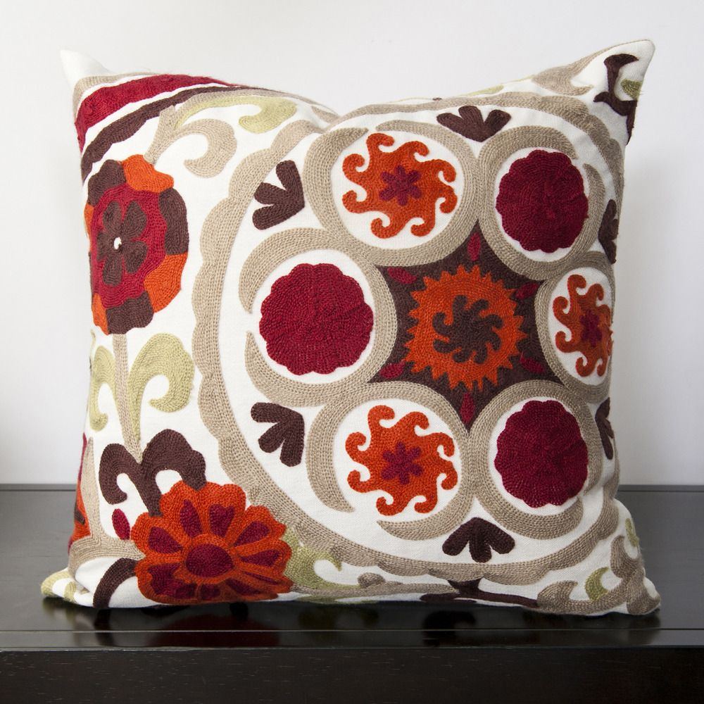 This fun floral pattern adds the perfect finishing touch to your décor. Colors of moss, maroon, paprika, dark chocolate, taupe, and white accent this decorative pillow.