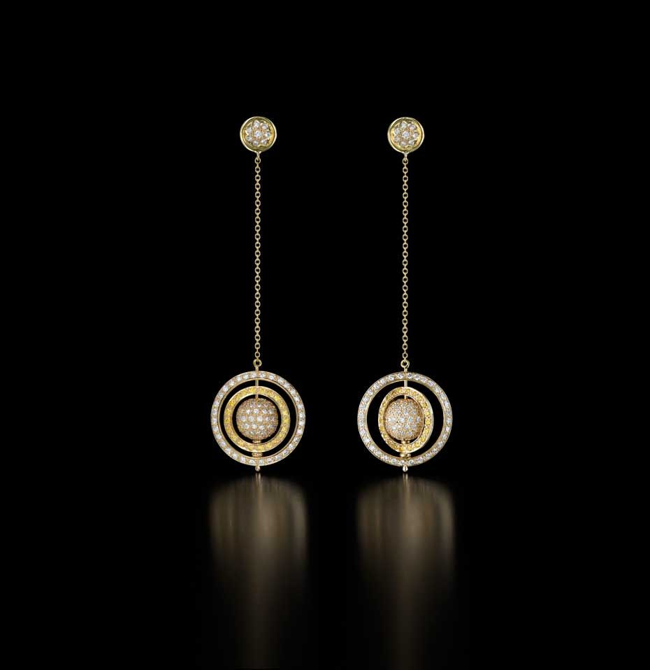 Liv Ballard Spinning Orb earrings in gold with yellow and white pavé diamonds.