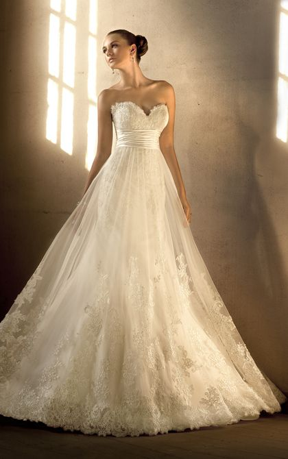 This gorgeous empire waist designer bridal gown can be worn with or ...