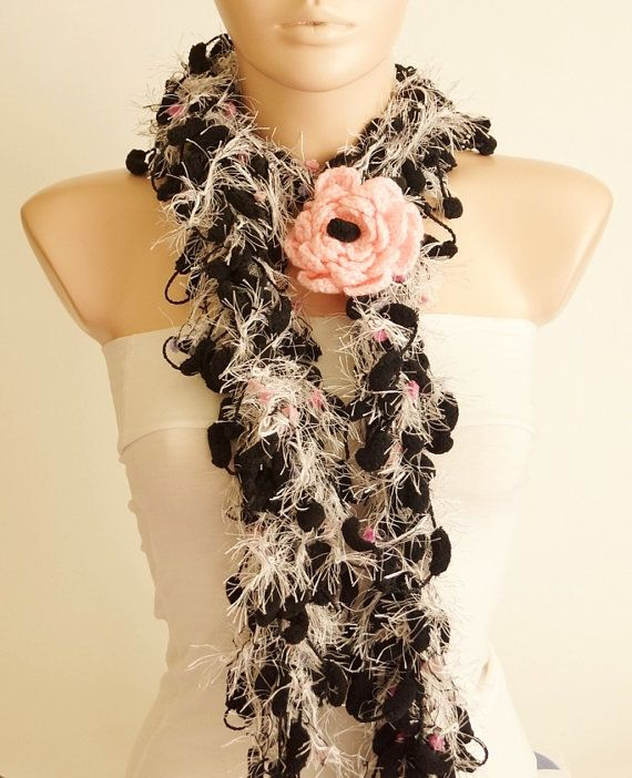 Super super new scarf. It is a new design and yarn. It calls puffy. It is very soft and very smart.    COLOR: Black, white  Size: 3 cm X 175 cm (1.18inch