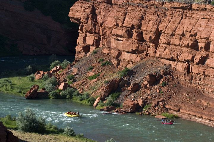 Whitewater rafting through canyons is the perfect adventure while you're in Wyoming. Book your guided excursion today and be prepared to get wet!