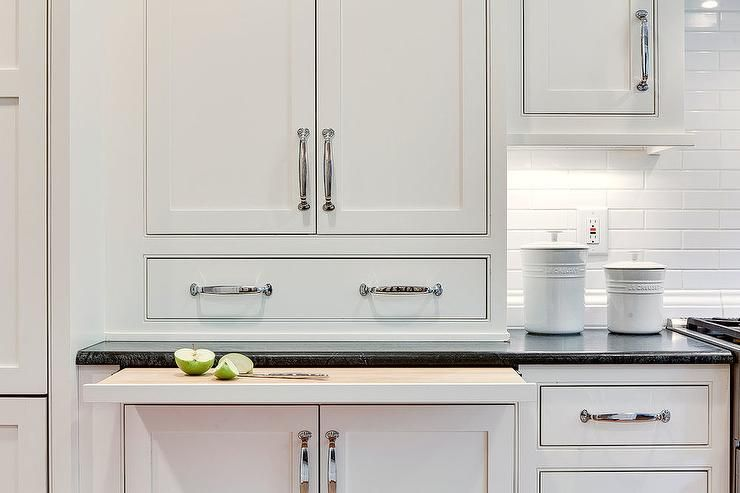 White shaker cabinets accented with polished nickel pulls ...