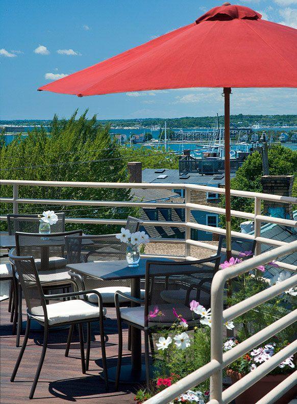 Enjoy breakfast on the rooftop patio overlooking the harbor at Mill Street Inn, Newport, Rhode Island