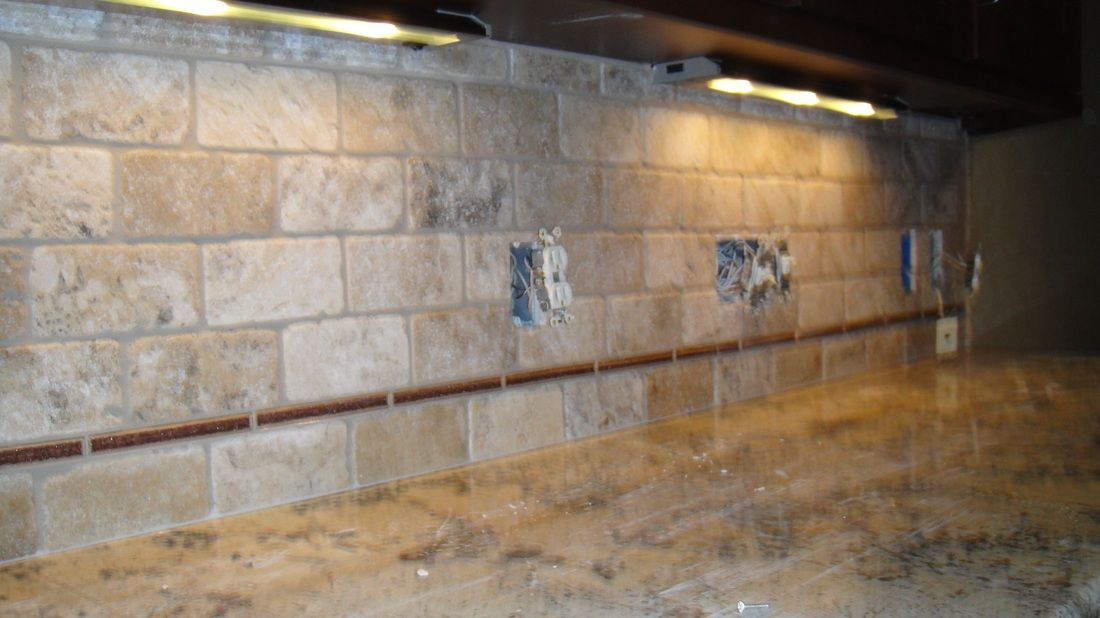 tumbled limestone tile backsplash