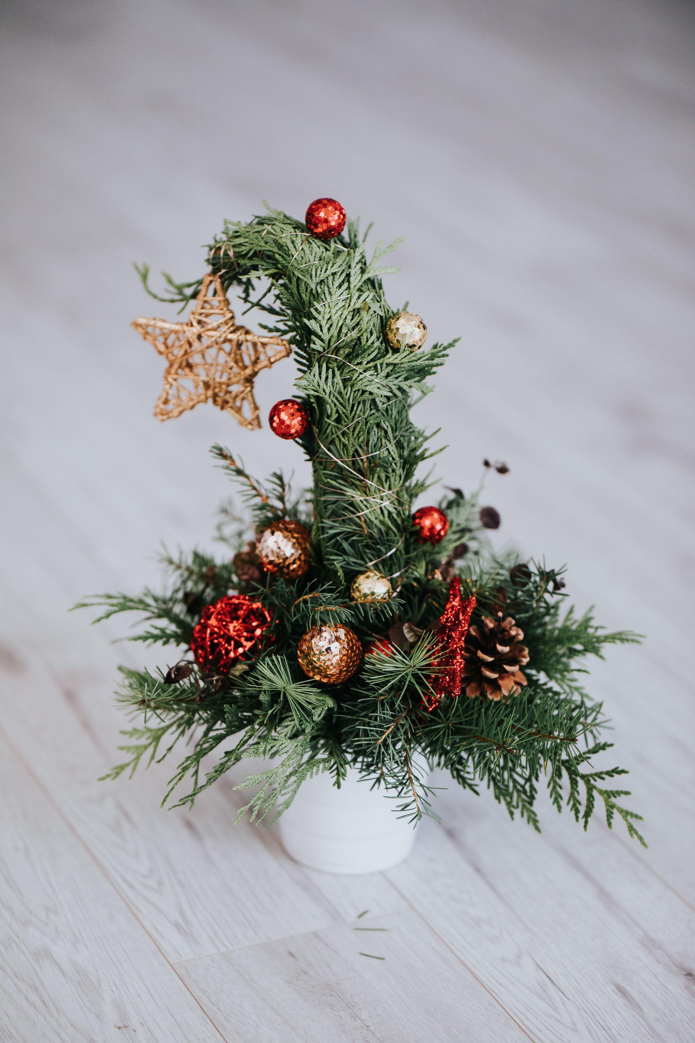 Fresh cedar grinch tree centerpieces for a festive holiday