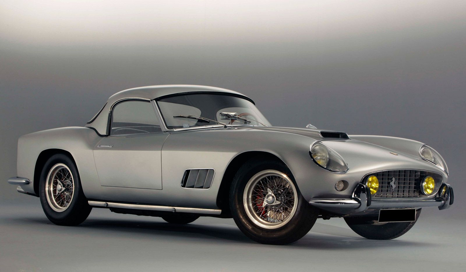 1959 Ferrari 250GT California Spider LWB - I have always been more of a Lambo guy. For reasons beyond looks. Like why the founder of Lamborghini started the company. But this... this 250 GT California is a classic. :)