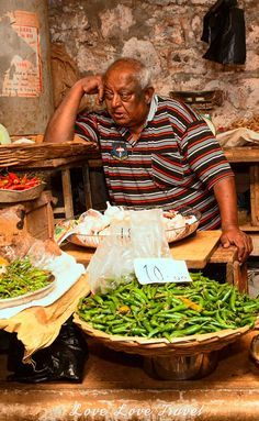 Port Louis Central Market, Mauritius: We met a lot of happy people in Mauritius but this salesman clearly was not having a good day at the Port Louis Central Market.