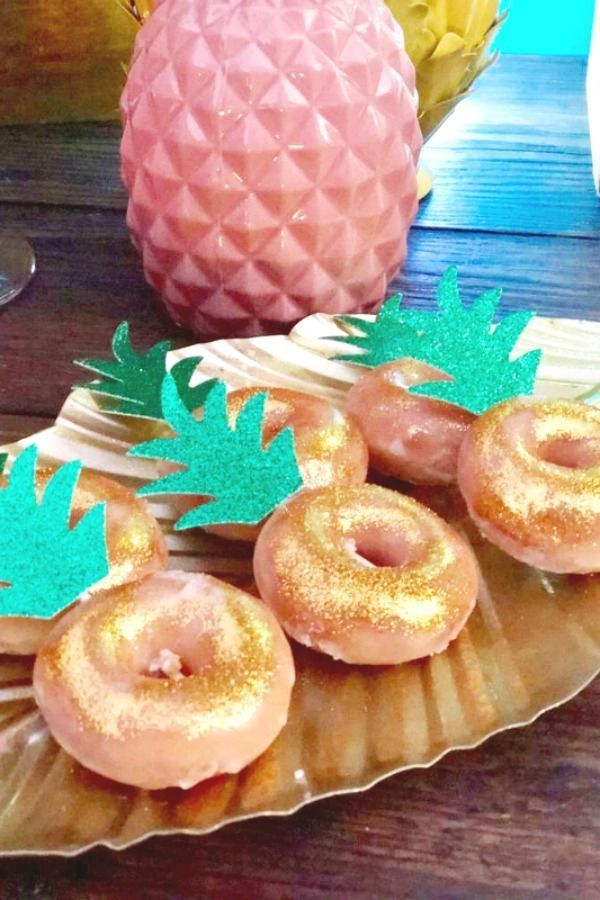 You can almost feel the sun with this stunning tropical party! The pineapple donuts are so much fun! See more party ideas and share yours at CatchMyParty.com #catchmyparty #partyideas #tropicalparty #summerparty #donuts #pineappledonuts #luaudonuts #tropicalbirthdayparty