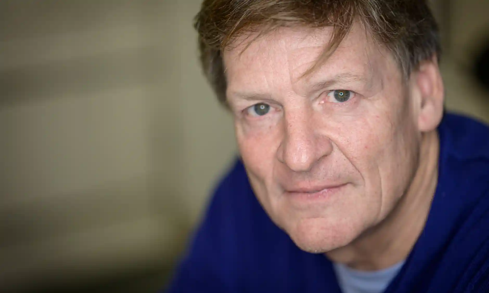 Michael Lewis 'Trump is like a psycho dad to America' in