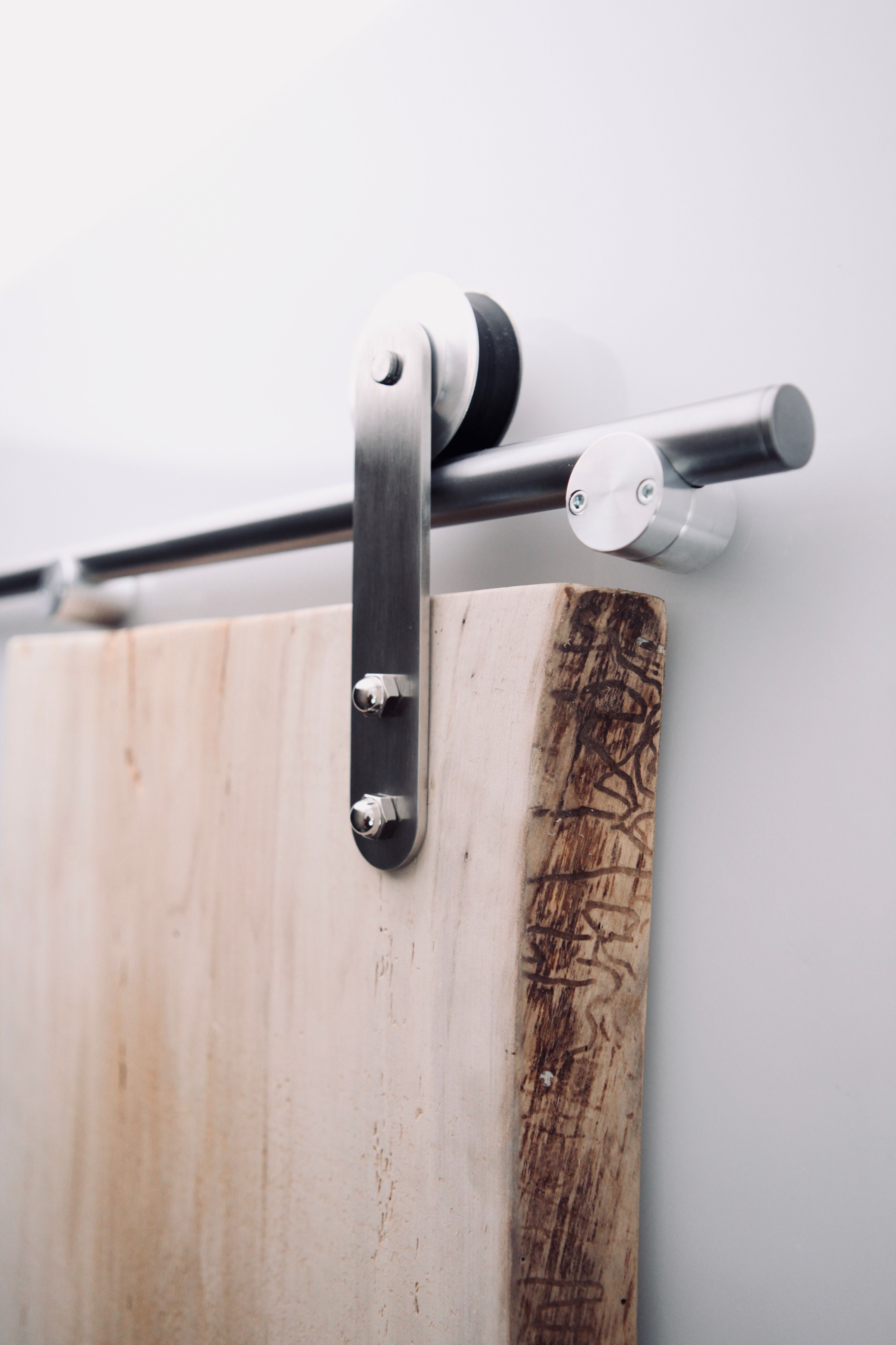 Our Rustica Modern Barn Door Hardware Tube Track Is The Easiest And Cleanest All Made In The Usa Barn Door Hardware Sliding Barn Door Hardware Door Handles