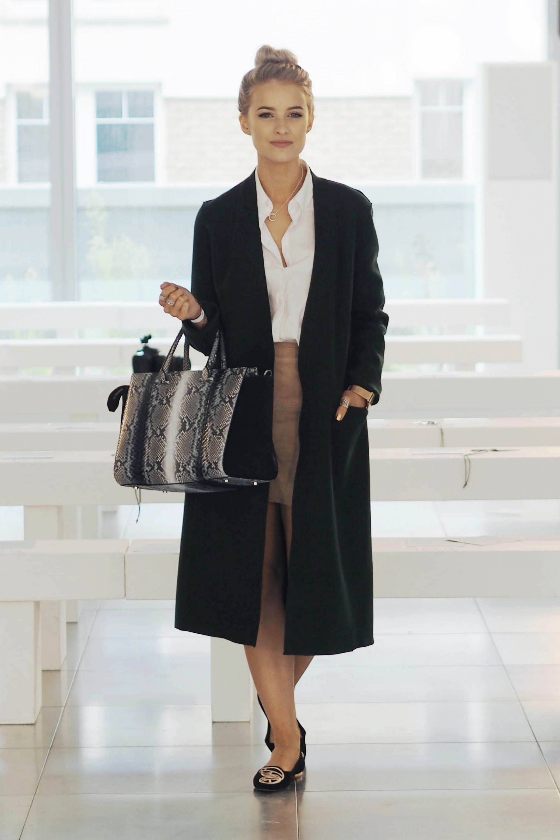 Amanda Wakeley python tote, with a long green wool coat, suede tan skirt and sophia webster butterfly flats for london fashion week