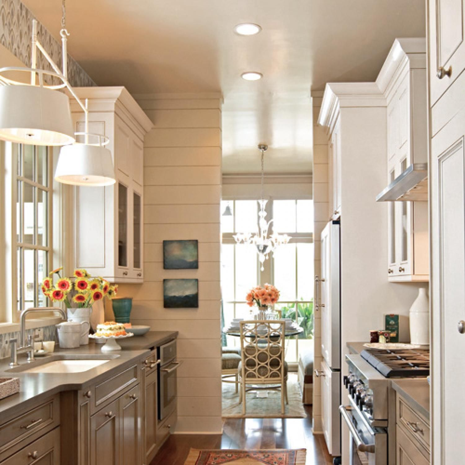 in the kitchen pictured above sophisticated earth tones and furniture style molding warm the s on kitchen interior small space id=36519