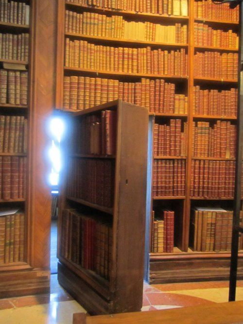 Bookshelf that swivels to reveal a hidden room