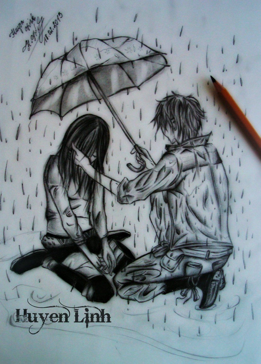Boy and girl in the rain