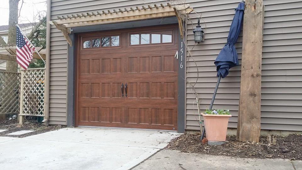 Amarr Garage Door Oak Summit In Walnut Stain House Exterior Garage Doors House Front Door